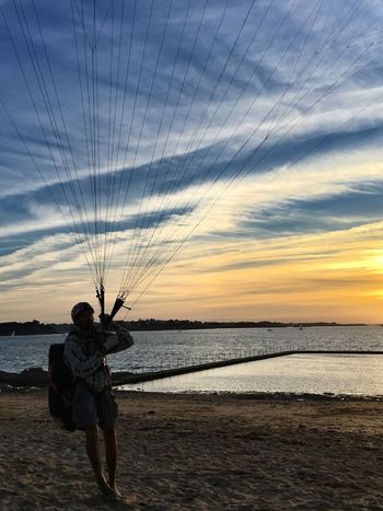 Capture the clouds... Sunset Beach Beauty In Nature The Color Of Sport In The Air Capture The Moment Extreme Sports Life Is A Beach AMPt - Shoot Or Die Capturing Freedom Street Photography Parachute Sea Sky