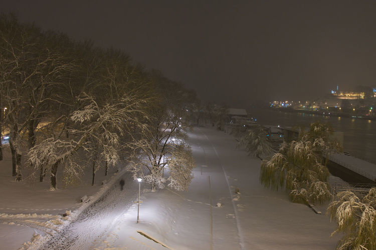 View of illuminated city at night during winter