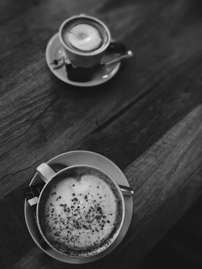 Drink Coffee - Drink Frothy Drink Refreshment Coffee Cup Food And Drink Table Cup Saucer Freshness Indoors  Espresso Latte High Angle View Cappuccino Tea - Hot Drink No People Wood - Material Drinking Glass Close-up