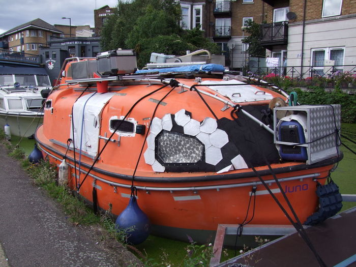 Lifeboat converted to Canal Boat Composition Conversion GB Lifeboat London Regents Canal Sunlight Unusual Algae Canal Canal Boat Canal Side Capital City Full Frame Mode Of Transport Moored Nautical Vessel No People Orange Colour Outdoor Photography Stationary Transportation Tree Uk Weeds