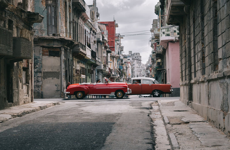Havana Cuba Streetphotography Architecture Motor Vehicle Built Structure Mode Of Transportation Car Transportation Building Exterior Land Vehicle Street City Building Red Road Day Residential District Sky Direction The Way Forward Outdoors No People