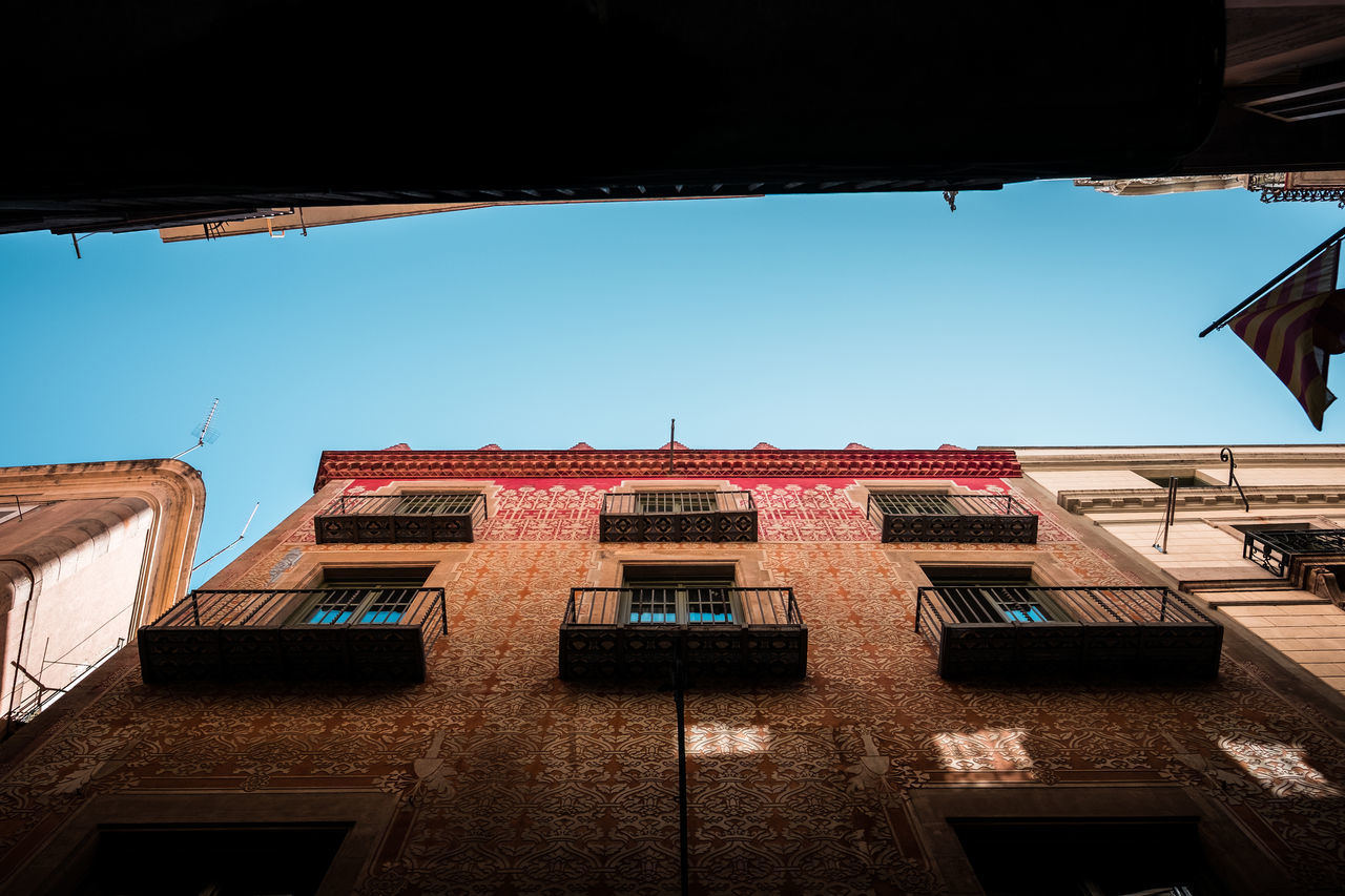 building exterior, architecture, built structure, window, low angle view, outdoors, no people, day, clear sky