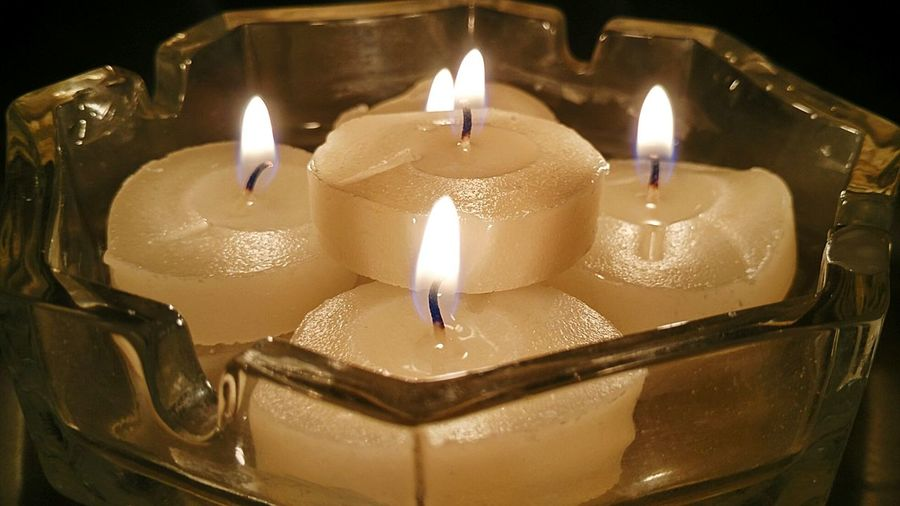 Close-up of lit candles