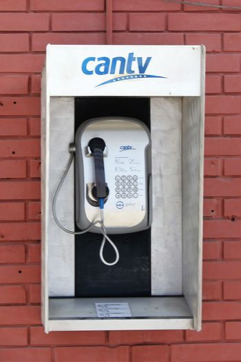 cantv Public Telephone on Isla Margarita Cantv Payphonesstillexist Public Telephone Brick Wall Close-up Communication Connection Convenience Day Isla Margarita No People Outdoors Pay Phone Payphone Payphone On Every Corner Payphone Telephone Payphones Of The World Technology Telecommunications Equipment Telephone Telephone Booth Telephone Receiver