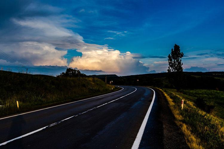 E60 Mihai Viteazu Romania Asphalt Beauty In Nature Blue Cloud - Sky Day Dividing Line Grass Landscape Mountain Nature No People Outdoors Road Road Marking Scenics Sky The Way Forward Tranquil Scene Tranquility Transportation