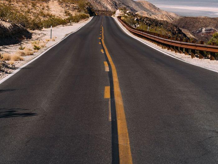 Empty road along highway