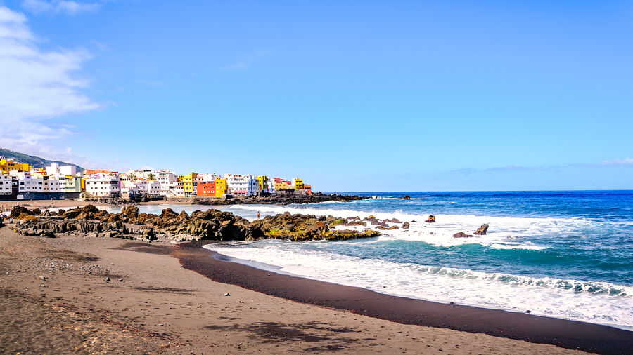 """On the beach Playa Jardín in Puerto de la Cruz. I am standing on one of the most beautiful beaches in the north of Tenerife. On the beach Playa Jardin, in Puerto de la Cruz .. A special feature of this beach is the volcanic sand, which is pleasantly warm even in cloudy weather, so it can be on this sand very well and relax. In the far west of Puerto de la Cruz, directly after the Playa Jardin, lies the small hamlet of Punta Brava. As Punta Brava, the """"Wild Corner"""" came to his name, is quite obvious, at least during the winter months. The Atlantic pushes huge waves of mountains to the small village, these threaten to devour the built directly on the cliffs houses. The houses line up closely to protect each other from the harsh sea climate. Many are severely attacked by salt in the air. Atlantic Ocean Bay Area Canary Islands Coastline EyeEm EyeEm Nature Lover EyeEm Selects EyeEm Gallery Feliz-Photo Playa Jardin Playa Jardin Puerto De La Cruz SPAIN San Felipe Bay Beach Coast Eye4photography  Playa #beach Rock - Object Rocks Sandy Beach Tenerife Teneriffa Tourist Destination"""