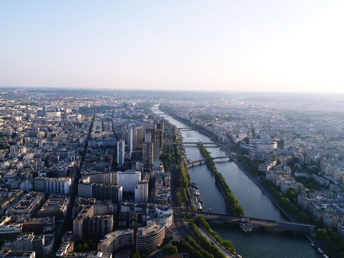 High angle view of siene river amidst buildings in paris city against clear sky