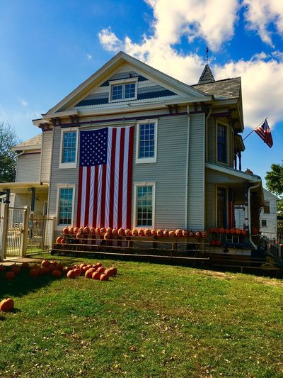 Building Exterior Architecture Built Structure Flag Patriotism Outdoors Grass Travel Pumpkin House Huntington, WV Tradition Spooky Jack O Lantern Celebration Halloween Pumpkin