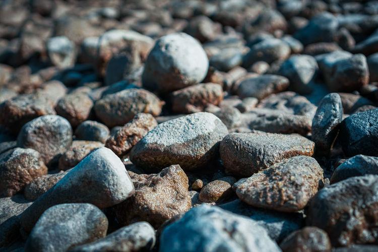 Full frame shot of wet pebbles on a beach
