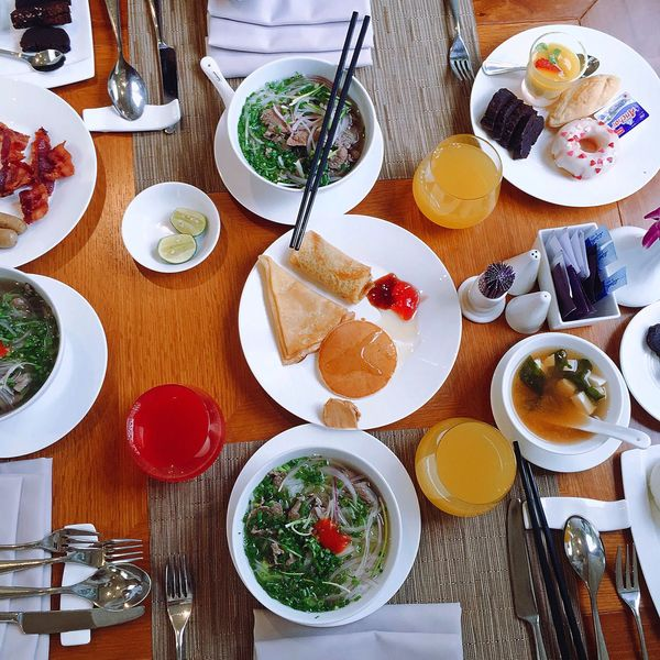 Breakfast Buffet Table Food And Drink Bowl Pho Food No People Dining Table Vietnam Travel Colorful Donut Brownie Juice Soup