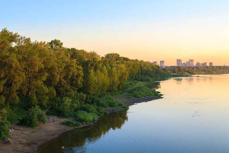 Summer evening at the river Tom in Kemerovo city. Riverside Siberian Husky Trees Built Structure Clear Sky Growth Outdoors Reflection River Riverbank Riverscape Siberia Sky Summer Sunset Tranquility Water Waterfront