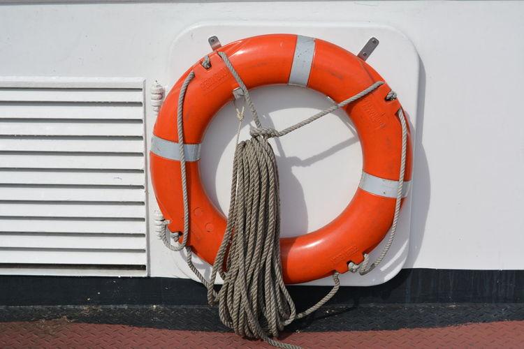 Life belt Boat Boat Deck Circle Day Emergency Equipment Life Belt No People Orange Color Outdoors Safety Security Transportation