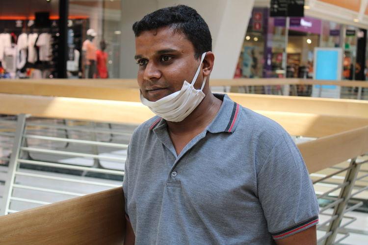 Man wearing mask standing in restaurant