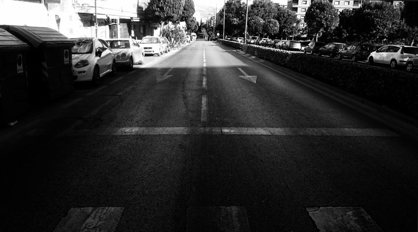 Architecture Black And White Blackandwhite Building Exterior Built Structure Car City Diminishing Perspective Direction Dividing Line Land Vehicle Marking Mode Of Transportation Monochrome Motor Vehicle No People Outdoors Road Road Marking Sign Street Symbol The Way Forward Transportation