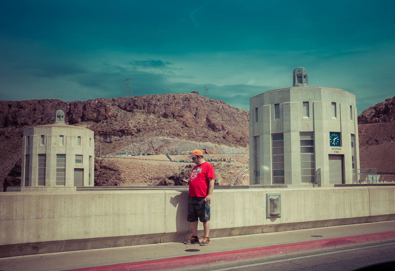 Tourist at Hoover Dam, Nevada, Arizona, USA Amazing Architecture Architecture Colorado River Dam Dam Lake Historical Building Holidays Hoover Dam Lake Mead Person Tourism Tourist Tourist Attraction  Tourist Destination Tourists Travel Photography Traveling Vacation Vacations Water Reservoir