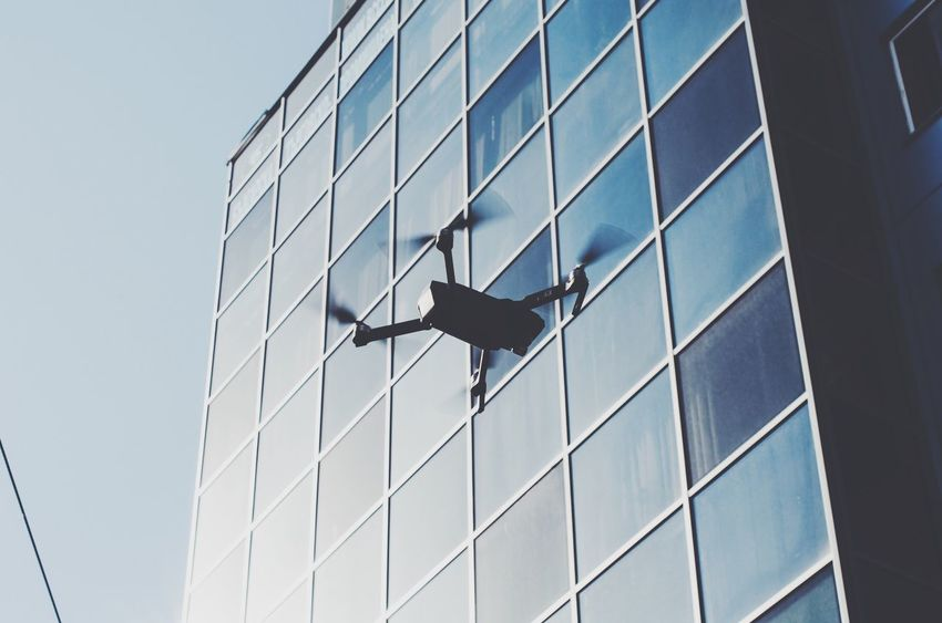 drone taking off Technology Tech Drone  Architecture Window Building Exterior Glass - Material Built Structure Modern Mobilephotography Fly Low Angle View Day Outdoors City