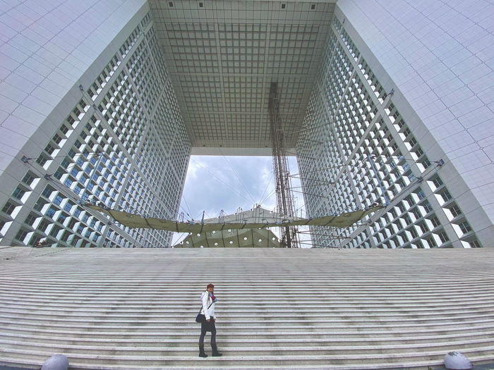 Woman standing on modern bridge