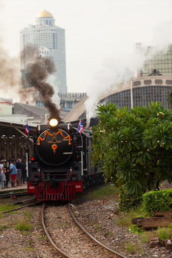 Train on railroad tracks in city