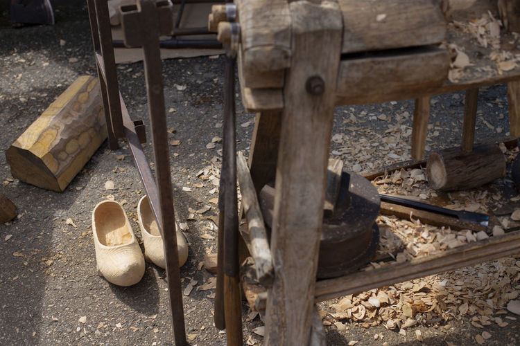 High angle view of old shoes on wood
