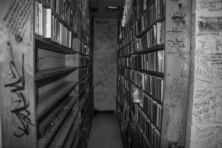 Black and white of music library Abundance Alley Architecture Book Bookshelf Building Built Structure Collection Communication Education History In A Row Indoors  Large Group Of Objects Library No People Old Publication Shelf Text The Past