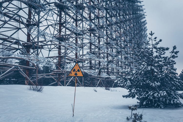 1986 Chernobyl Chernobyl Power Station Chernobyl Tour Explosion Get Your Guide Get Your Guide Tour Jake Longley Jake Longley Photography Kiev Nuclear Power Power Station Pripyat Russia Ussr Ukraine Snow Winter Cold Temperature Tree Sign Nature Plant Covering Communication No People Road Sign Day Warning Sign Built Structure Sky Architecture Outdoors Road White Color