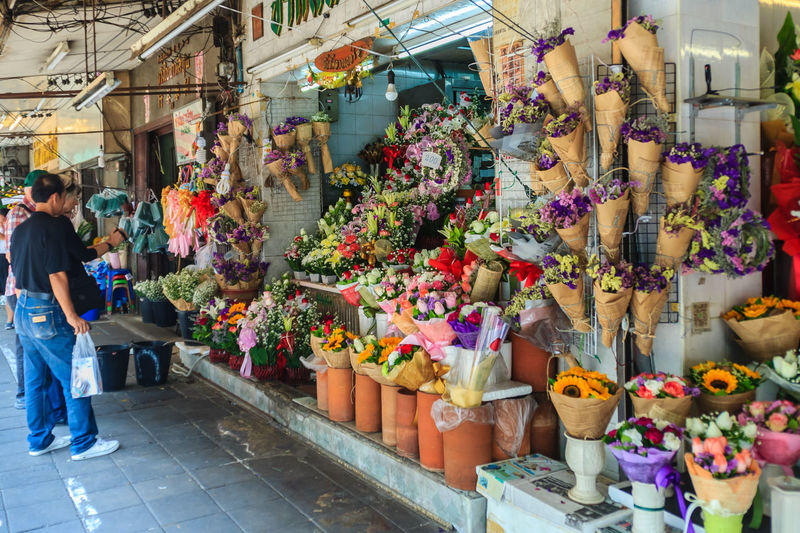 """Bangkok, Thailand - March 2, 2017: Flower shop selling variety of flowers at the flower market named """"Pak Khlong Talat"""" in Bangkok. Pak Klong Talad is the biggest flower market in Thailand. Bangkok Flower Bangkok Flower Market Flower Market Flower Shop Flowers Pak Khlong Flower Market Pak Khlong Talat Abundance Arrangement Buying Choice Collection Consumerism Day Florist Flower Flower Collection Flower Market Bangkok Flower Market Thailand Flower Shop Flowerseller For Sale Group Of People Large Group Of Objects Market Market Stall Multi Colored Outdoors Real People Retail  Retail Display Sale Shopping Small Business Store Street Market Variation Women"""