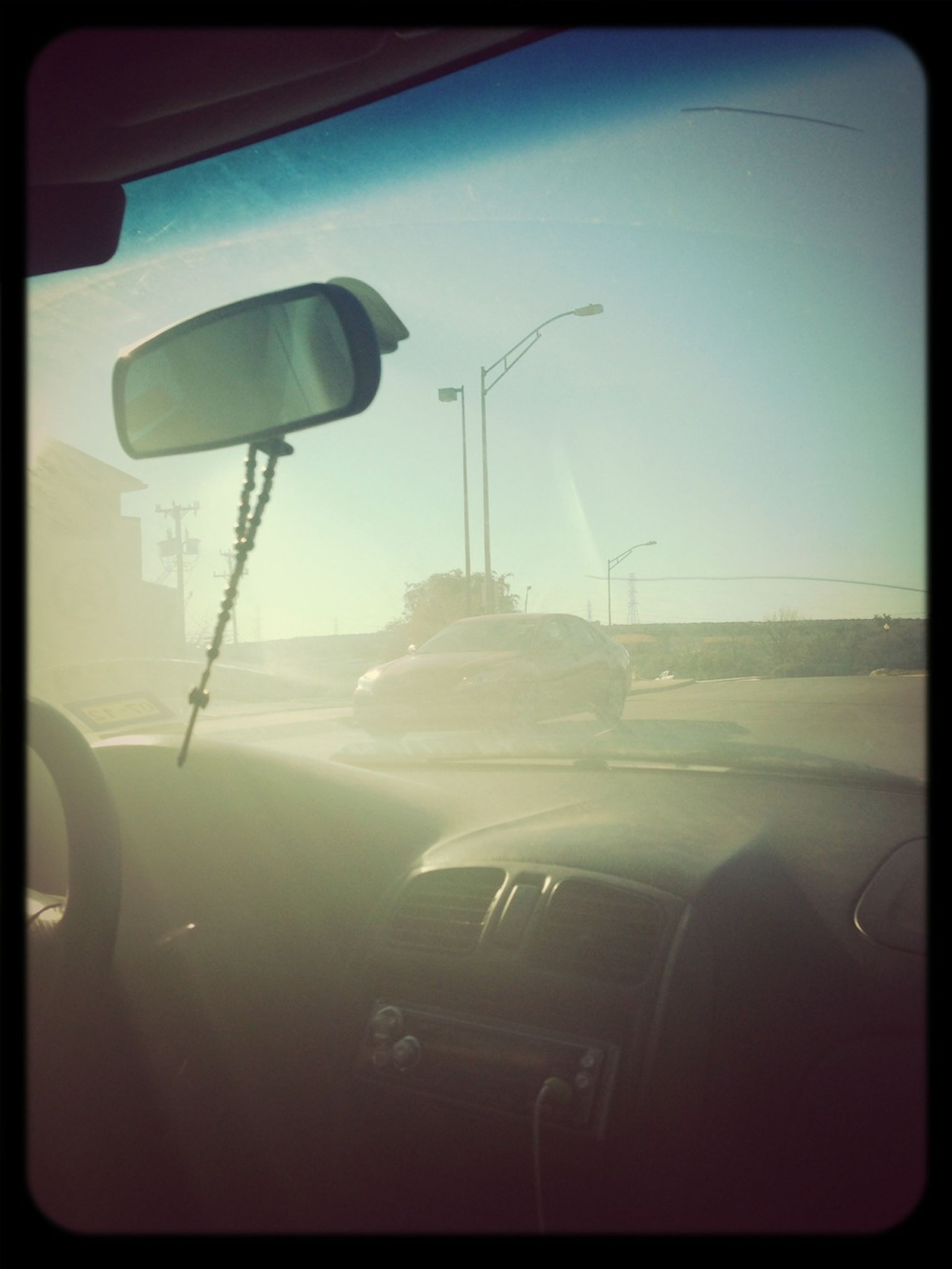 transportation, mode of transport, car, vehicle interior, land vehicle, transfer print, airplane, glass - material, travel, windshield, transparent, air vehicle, street light, sky, window, auto post production filter, on the move, public transportation, car interior, journey