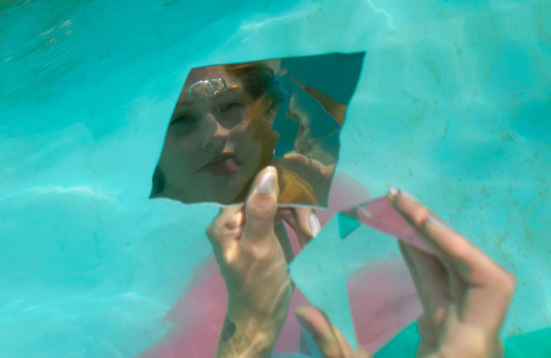 Reflection of woman in mirror underwater