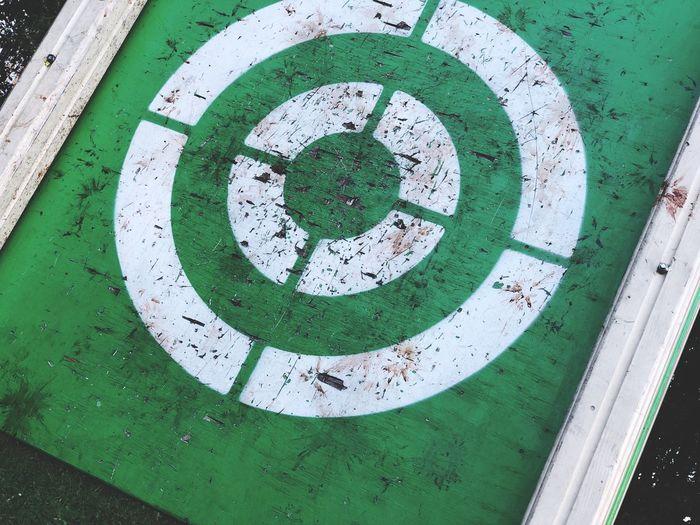 High angle view of arrow sign on metal