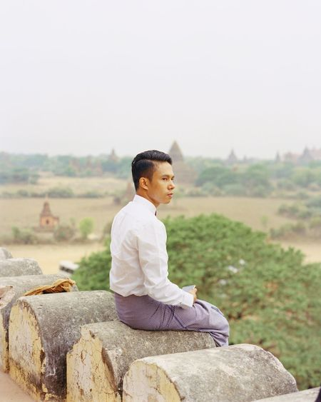 Sitting Real People Outdoors Side View Lifestyles BYOPaper! One Person Nature Landscape Beauty In Nature Clear Sky Tree Sky Young Adult People Bagan, Myanmar Old Bagan Myanmar Portrait EyeEm Film Photography Kodak Break The Mold The Great Outdoors - 2017 EyeEm Awards The Portraitist - 2017 EyeEm Awards