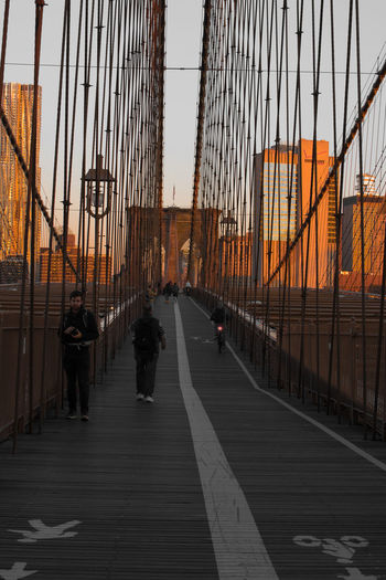 Brooklyn Bridge Architecture Transportation City Built Structure Sky Direction Bridge - Man Made Structure Suspension Bridge Connection Group Of People Bridge Sunset Men Travel The Way Forward Real People Tourism Walking Travel Destinations Outdoors