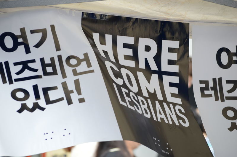 Close-up of text on placard stuck at fabric