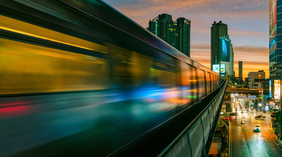 sky and the city Architecture Motion Blurred Motion Transportation City Public Transportation Mode Of Transportation Rail Transportation Built Structure Building Exterior Speed Train Illuminated Train - Vehicle No People Travel on the move Building Long Exposure Land Vehicle Track Outdoors Office Building Exterior Cityscape Subway Train