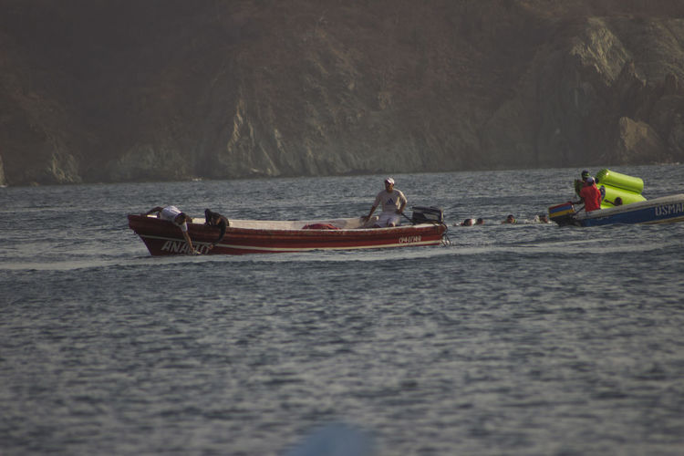 Adventure Beauty In Nature Day Men Mode Of Transport Nature Nautical Vessel Oar Outdoors People Real People River Rowing Taganga Taganga Colombia Taganga Colombia. Teamwork Togetherness Transportation Water Waterfront