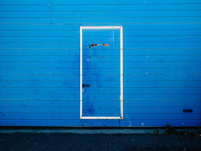 Closed Blue Door On Corrugated Iron