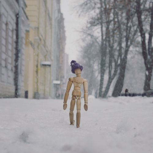 Walking through the snow City Life Creativity Streetphotography Snowstorm Woodyforest Human Representation Snow Cold Temperature Male Likeness Winter Art And Craft Weather Day