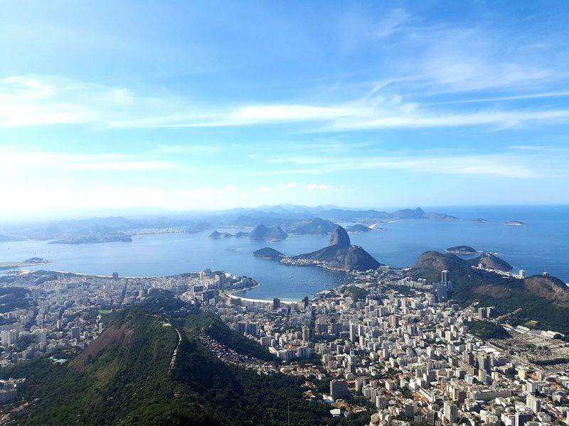 Looking down at Christ the redeemer, Rio in Brazil. Rio De Janeiro Rio 2016 Summer Olympic Christ The Redeemer Blue Sea End Of The Day