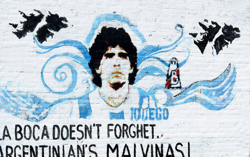 Madonna, Hand of God, Malvinas anti Falkland Islands protest post - Beunos Aires, Argentina Architecture Argentina Pic Beunos Aires Building Exterior Close-up Day Falkland Islands Graffiti Madonna Malvinas One Man Only Only Men Outdoors People Political Posters Street Art