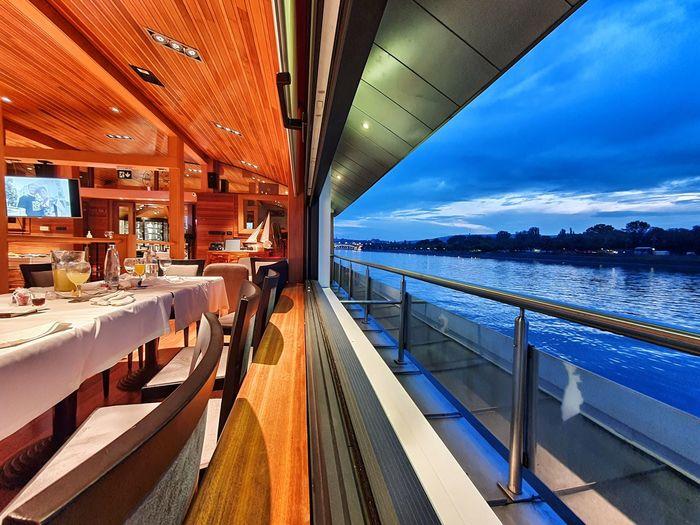 Interior of boat in sea against sky