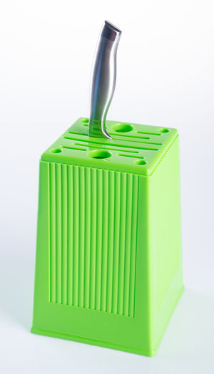 Close-up of knife block on gray background