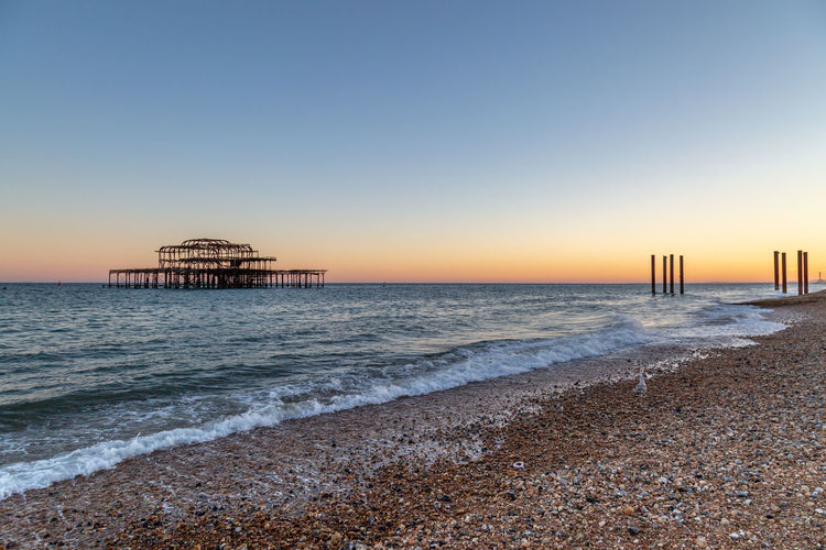 Looking across Brighton Beach towards the West Pier, with a sunset behind Brighton Architecture Beach Beauty In Nature Built Structure Clear Sky Horizon Horizon Over Water Iconic Land Motion Nature No People Outdoors Scenics - Nature Sea Sky Sunset Sussex Tranquil Scene Tranquility Water Wave West Pier