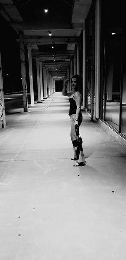 Rear view of women walking in corridor