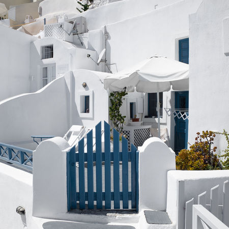 Santorini, Greece Apartment Architecture Barrier Building Building Exterior Built Structure City Day Fence House Nature No People Outdoors Plant Railing Residential District Santorini Sunlight Town White White Color Whitewashed