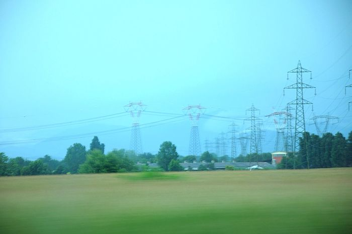 Electricity Pylon Connection Landscape Clear Sky Power Line  Cable Electricity  Grass Tranquil Scene Blue Field Tranquility Grassy Green Color Nature Italy Countryside Photo From A Train Window Train From The Train Power Supply Scenics TakeoverContrast