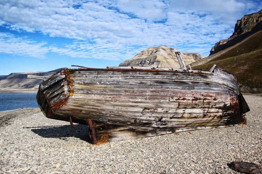 wrecked Boat at Spitsbergen Coast Abandoned Beauty In Nature Boat Cloud Cloud - Sky Damaged Day Mode Of Transport Mountain Nature Nautical Vessel Non-urban Scene Obsolete Old Outdoors Scenics Spitsbergen Spitzbergen Sunny Tranquil Scene Tranquility Transportation Weathered Wreck Wrecked