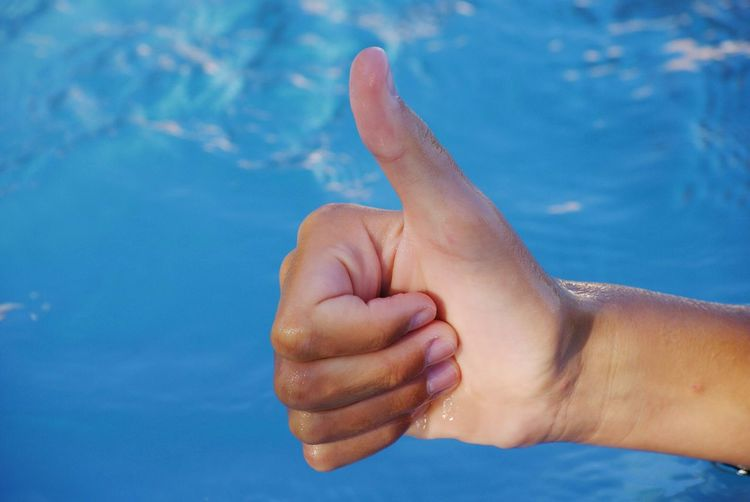 Cropped hand showing thumbs up