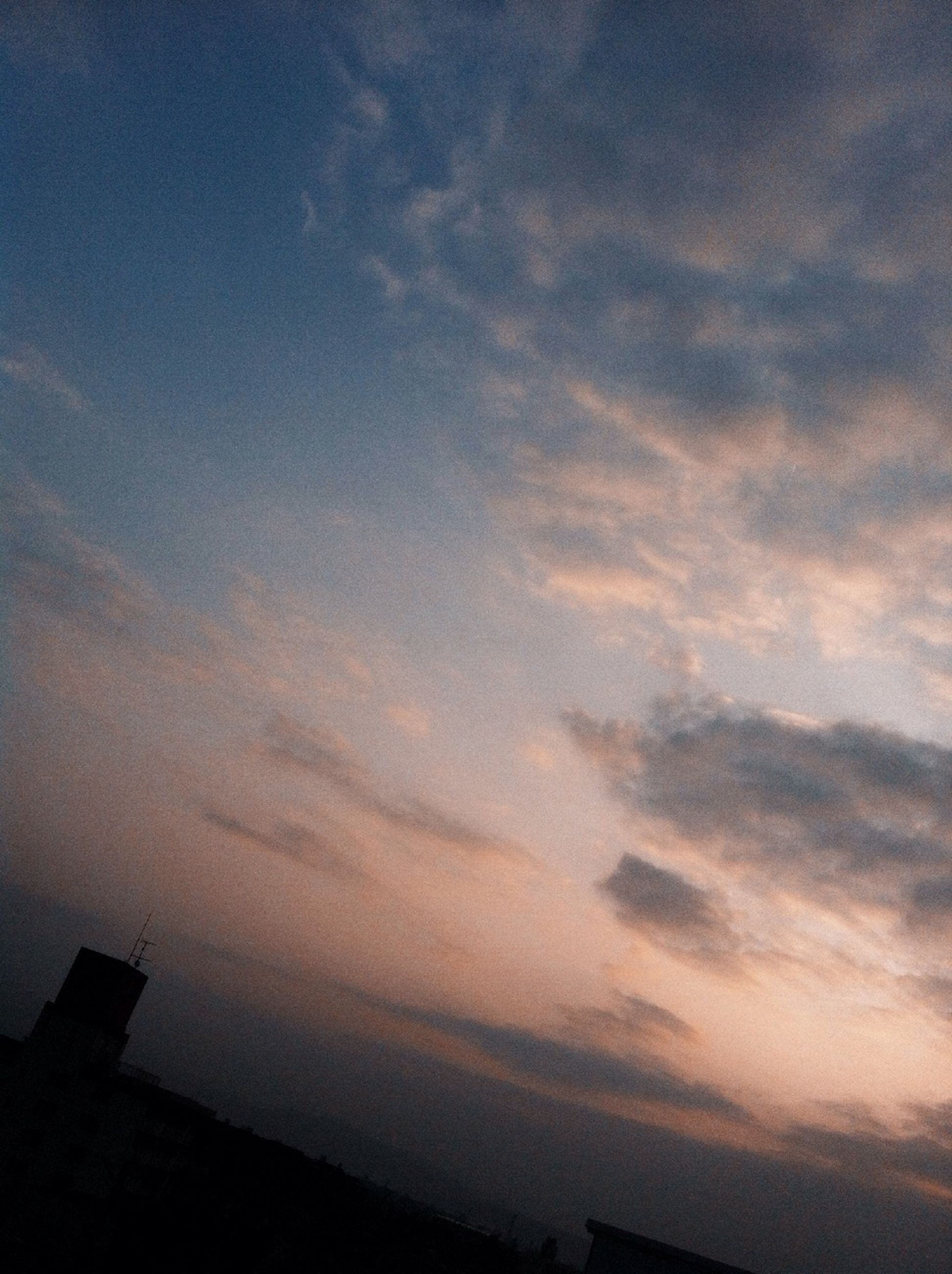 building exterior, architecture, sky, built structure, sunset, cloud - sky, silhouette, low angle view, cloudy, cloud, city, building, dusk, outdoors, beauty in nature, nature, scenics, no people, orange color, high section