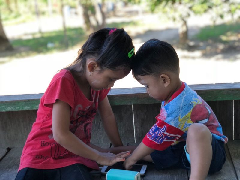 Just sister and brother Sister Home Togetherness Child Bonding Girls Two People Love Women Childhood Females Connection Positive Emotion Family Casual Clothing Real People Leisure Activity Lifestyles Sitting People Emotion Day