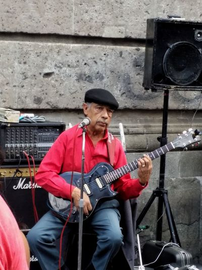 EyeEmNewHere Music Musical Instrument Hat Musician Arts Culture And Entertainment Playing One Man Only Only Men Electric Guitar Adult Guitar One Person Adults Only Sitting Performance Men People Plucking An Instrument Portrait Singing